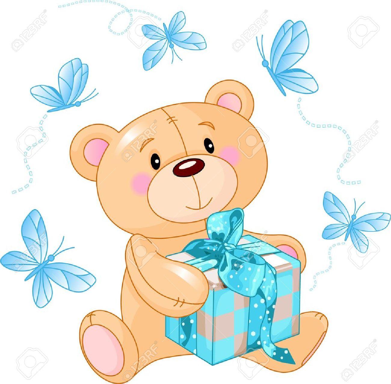 Cute Teddy Bear sitting with blue gift box.