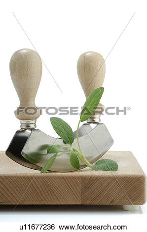 Stock Images of Cutting herbs with a mincing knife u11677236.