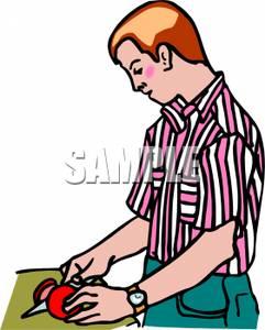 Man Cutting Up a Tomato.