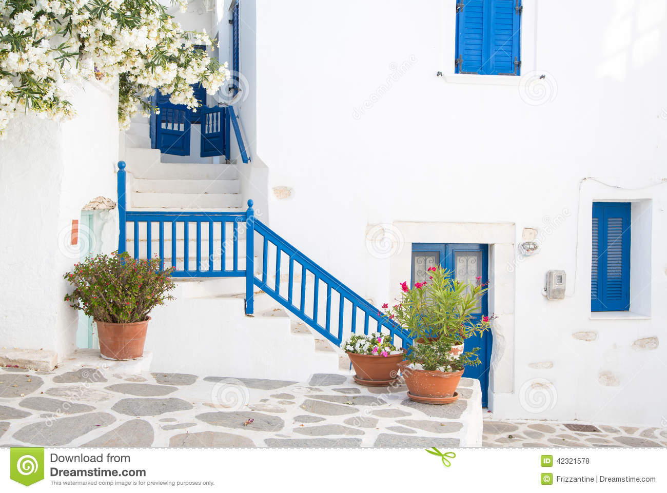Architecture On The Cyclades. Greek Island Buildings With Her Ty.