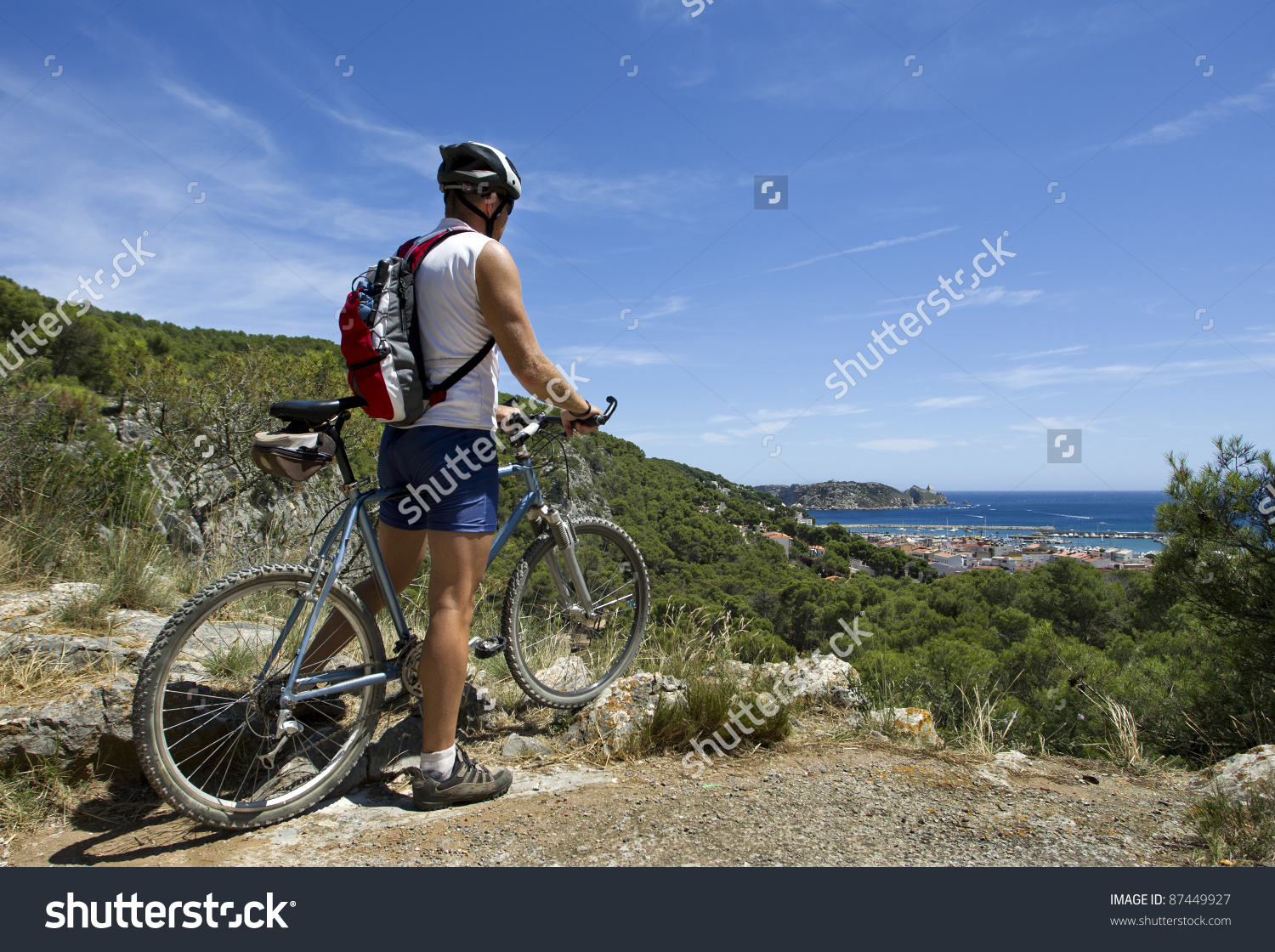 Man On Mountain Bike With View Of Mediterranean Sea In North East.