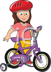 Young Girl with a New Bicycle with Training Wheels and a Helmet.