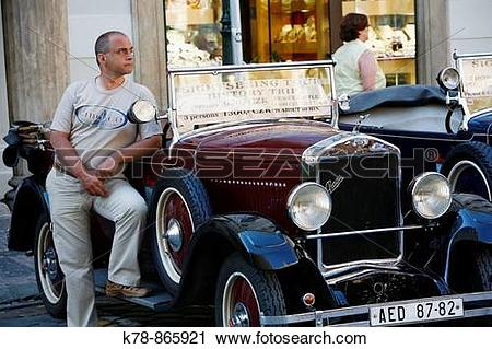 Stock Photography of Drivers standing by old Skoda car used for.