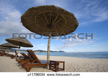 Stock Photo of Beach chairs and umbrellas on beach, Dadong Sea.