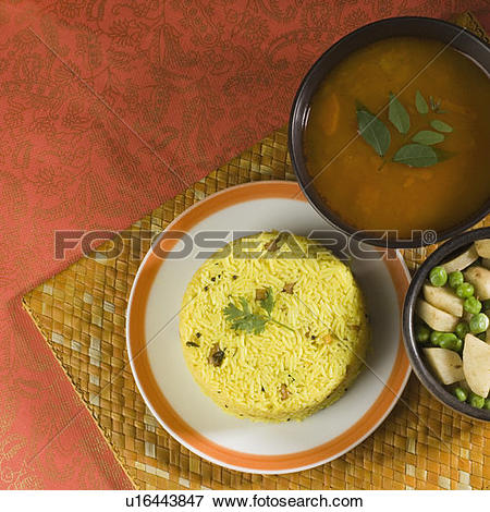 Picture of High angle view of rice in a plate with daal and fried.