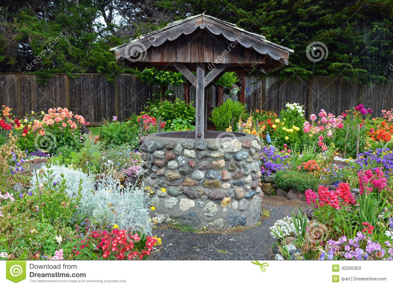 Wishing Well In Dahlia Garden Stock Photo.