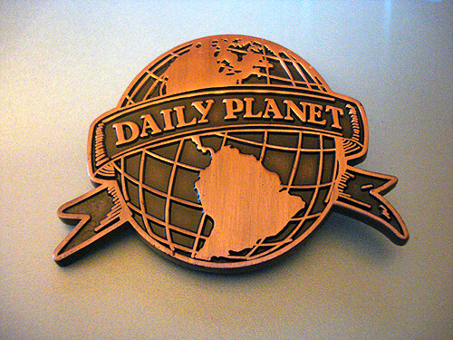 Daily Planet logo badge.