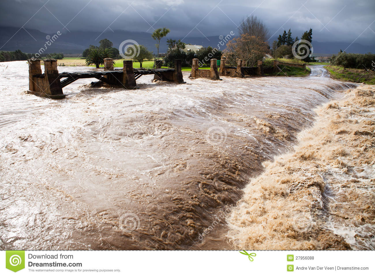 Flood River With Red Alluvial Flowing In Dak Lak, Vietnam Stock.