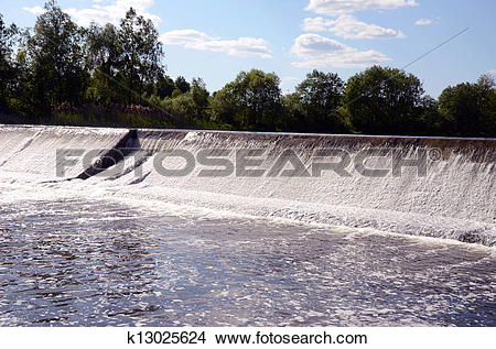 Stock Photo of dam construction on river and waterfall k13025624.