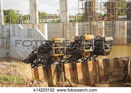 Stock Photo of Water pumps at dam construction site. k14223152.