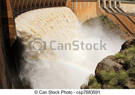 Stock Photography of Dam wall with open sluice gates.