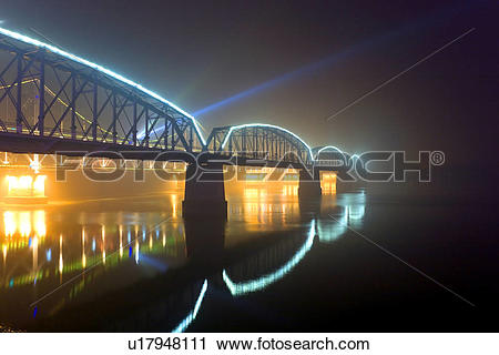 Stock Photography of The Broken Bridge at night Yalu river Dandong.