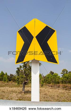 Stock Images of Road Signs warn Drivers for Ahead Dangerous Curve.