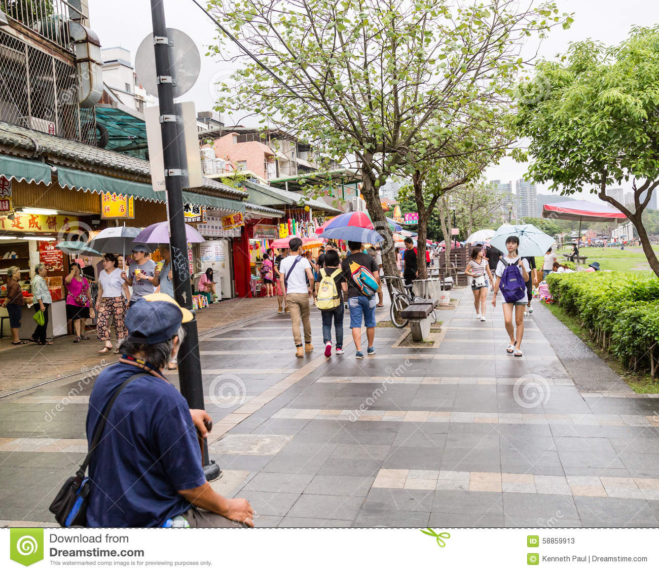 Shoppers Walking Around Danshui Old Street And Waterfront.