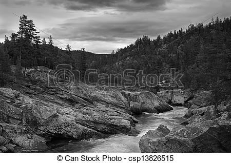 Stock Photography of Mountain brook black and white dramatic.