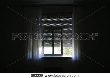 Stock Photograph of Sunlight coming in a window in a darkened room.