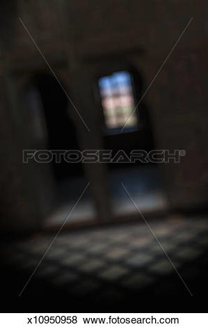 Pictures of Coloured glass window in darkened room x10950958.