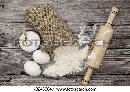 Picture of Wheat flour in a canvas bag, a large salt shaker wood.