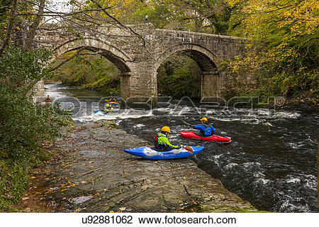 Stock Photo of England, Devon, Holne. People kayaking on the river.