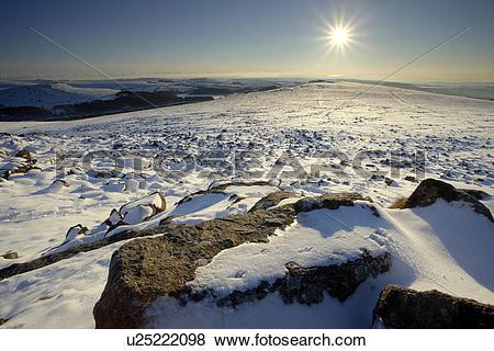 Pictures of England, Devon, Dartmoor. Winter sunburst over the.