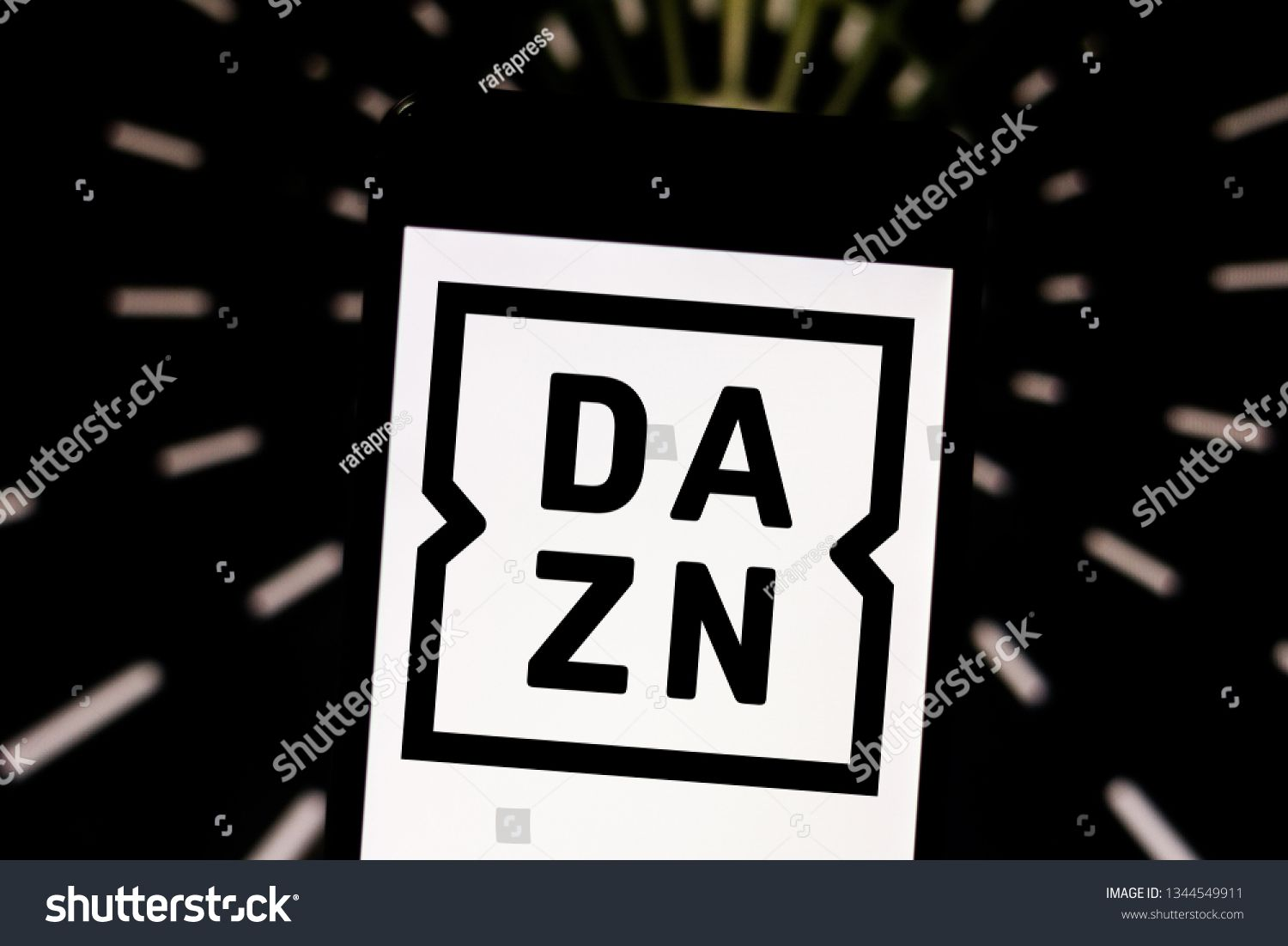 March 20, 2019, Brazil. DAZN logo on mobile device screen.