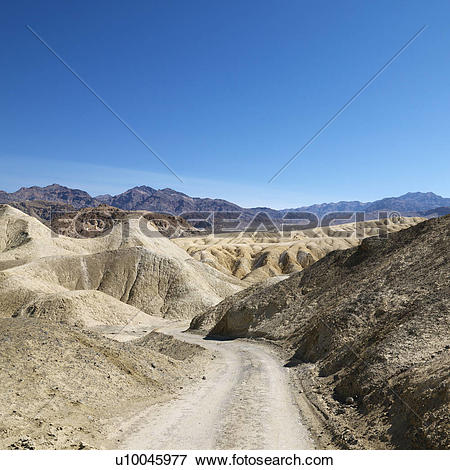Picture of Dirt road through barren landscape in Death Valley.