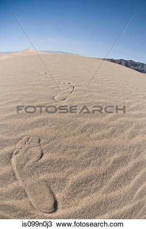 Stock Photo of Footprints in sand dune in Death Valley National.