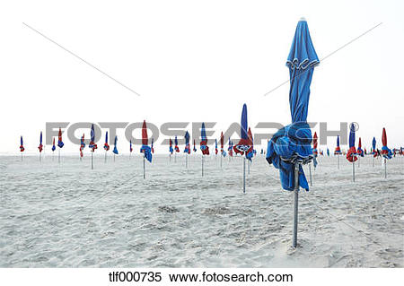 Stock Image of France, Normandy, Deauville, Sunshades on beach.