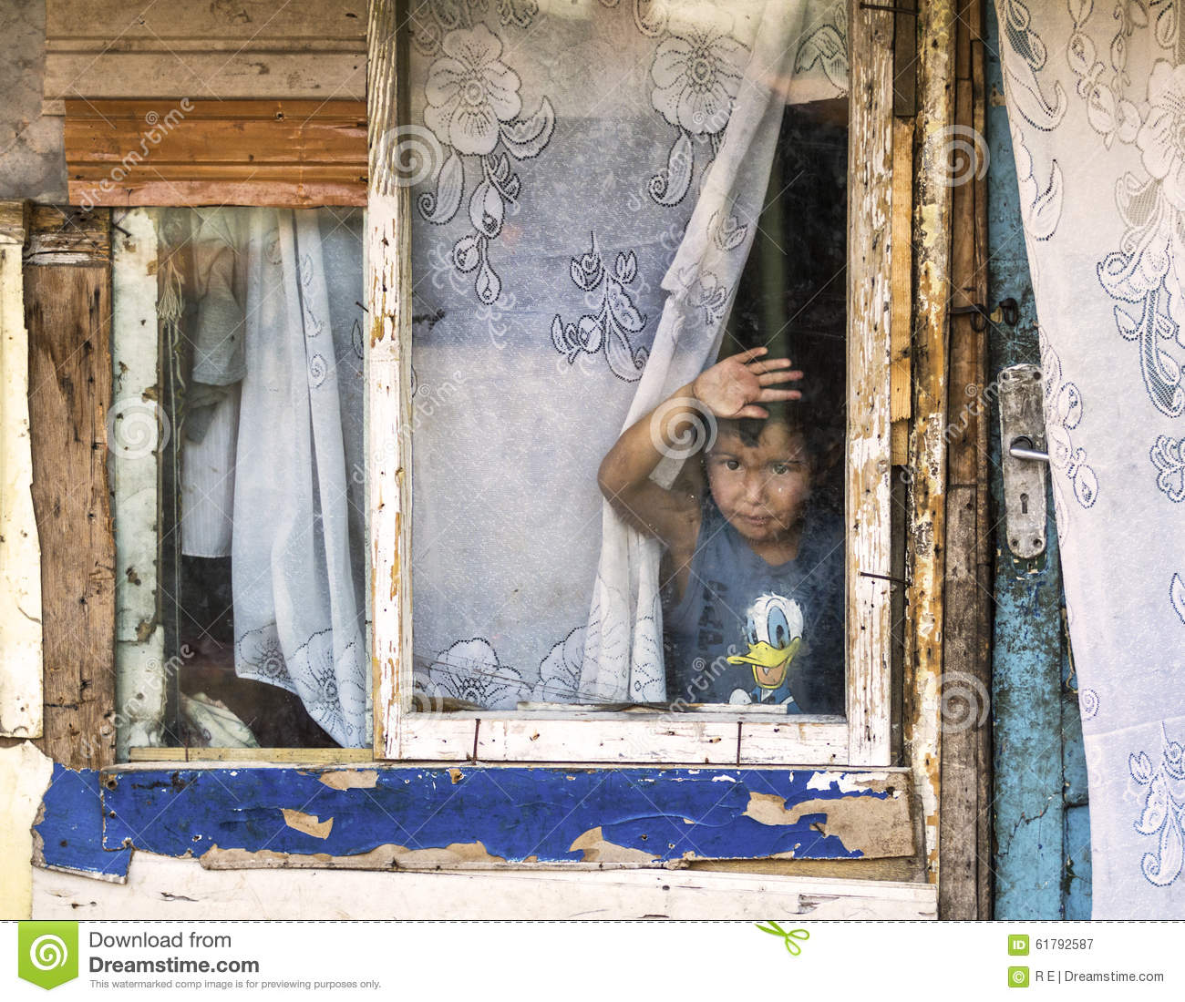 Poor Child In A Decaying House Editorial Photography.