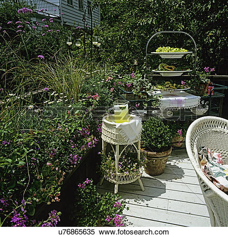 Stock Image of DECKS: Deck with lots of potted plants, container.