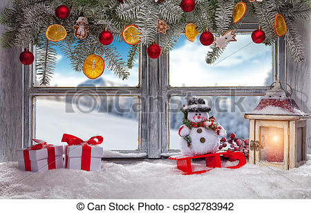 Stock Photo of Atmospheric Christmas window sill decoration with.