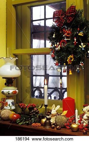 Stock Photo of Window sill in a country house with Christmas.