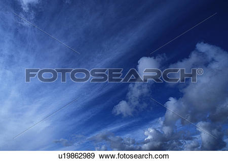 Stock Photograph of Streaks Of Clouds In A Deep Blue Sky u19862989.