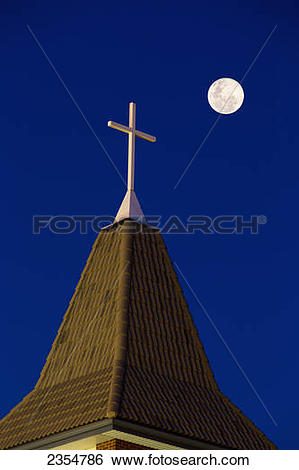 Stock Images of Close Up Of Church Steeple With Cross At Night.