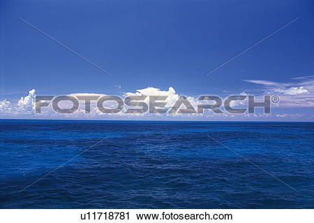 Stock Photography of the Deep Blue Ocean Under a Blue Sky and Some.