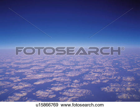 Stock Photograph of a Sea of Clouds, Under a Deep Blue Sky, High.