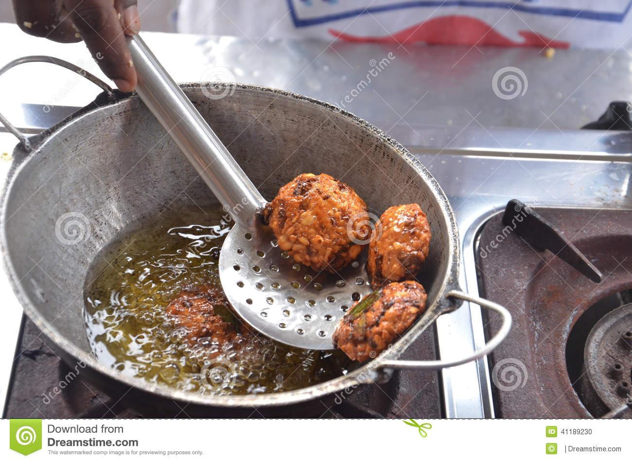 Deep Frying Pakora Stock Photo.