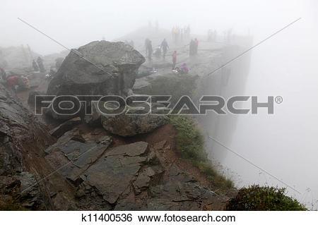 Stock Images of Preikestolen rock taken in deep fog, Norway fjord.