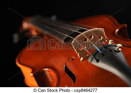 Picture of close up shot of a violin, shallow deep of field.