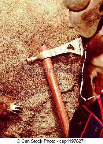 Picture of Peace pipe and deer hide.