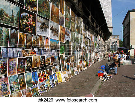 Stock Images of Poland Krakow, paintings by defensive walls at.