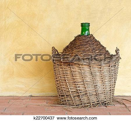 Picture of Old demijohn aka carboy for wine, wicker straw wrap, by.