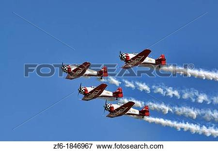 Picture of The Aeroshell demonstration team soars overhead in the.