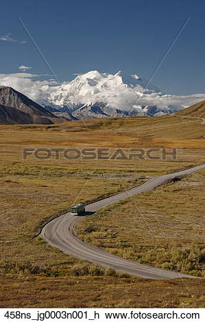 Stock Photo of Denali National Park shuttle bus heads towards.