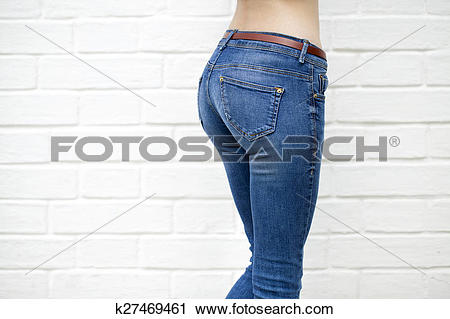 Stock Photography of Beautiful woman body in denim jeans on white.