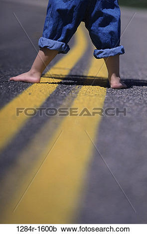 Stock Photography of road, street, body parts, feet, jeans, denim.