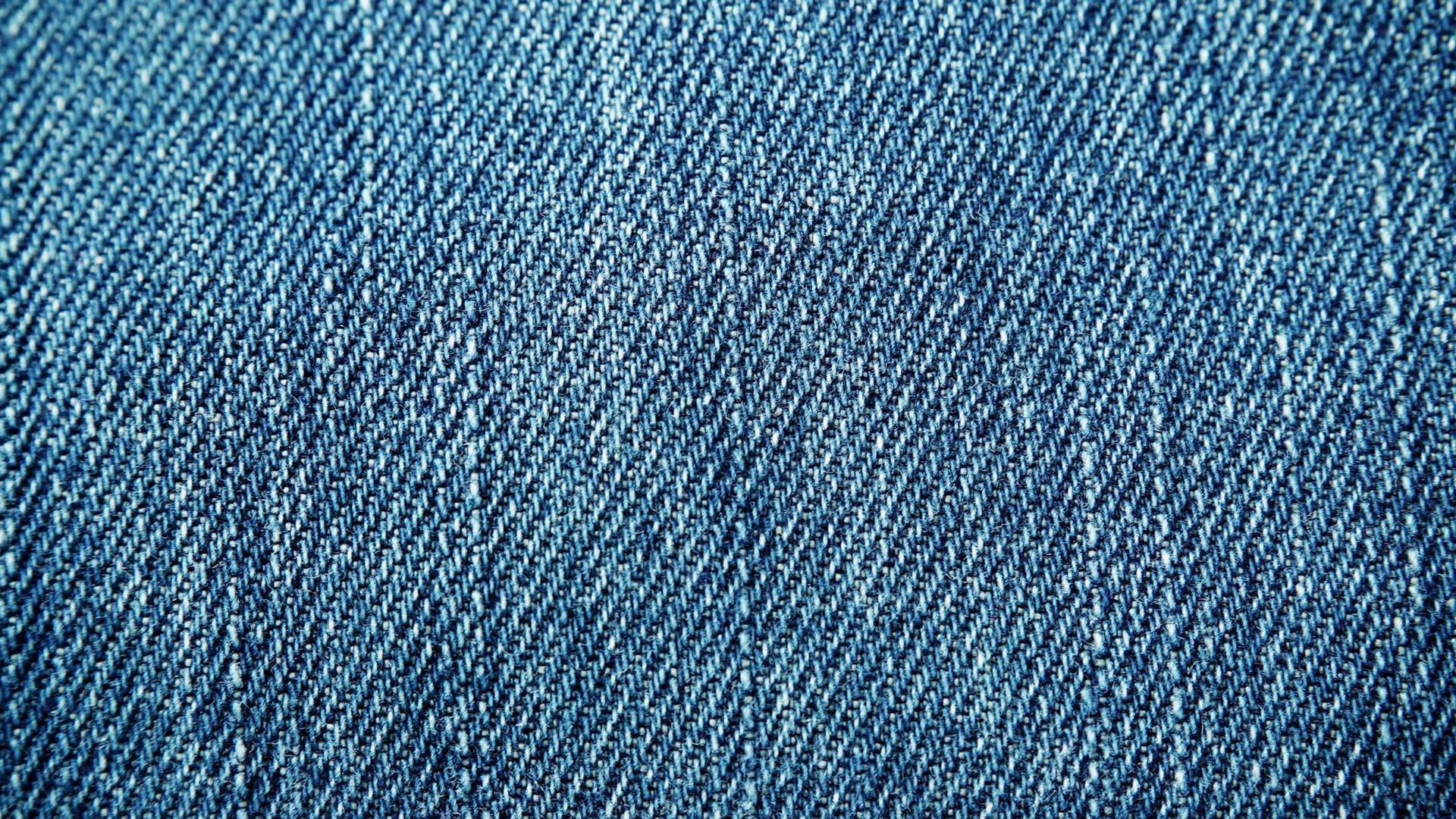 Closeup detail of blue denim jeans, texture background. Dolly sliding shot  4K ProRes HQ codec Stock Video Footage.