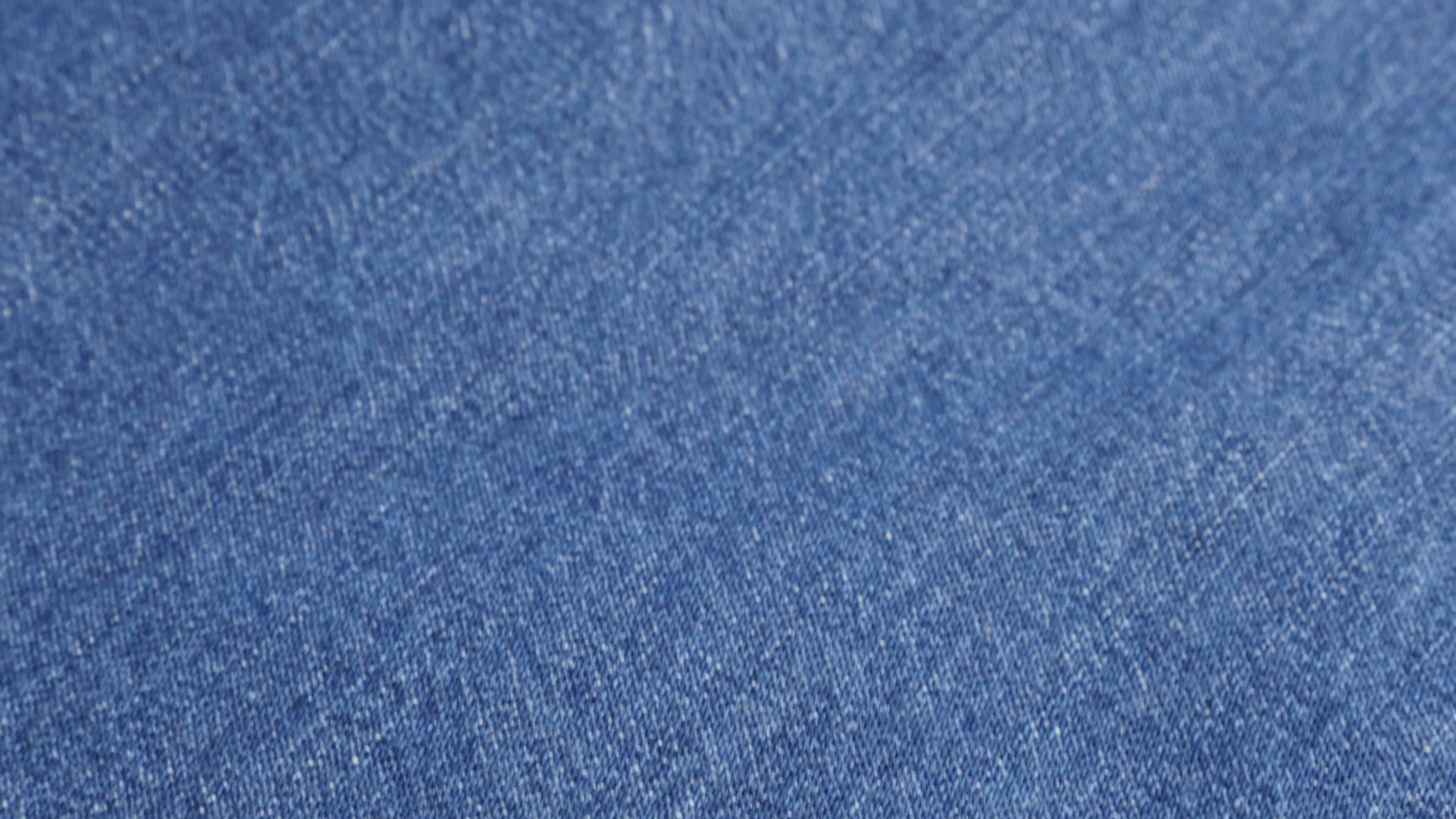 Dark blue high quality denim fabric details and texture close.