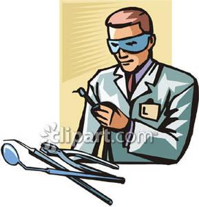 Technician Looking At Dental Instruments.