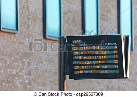 Stock Photography of Information panel with Dutch bus departure.